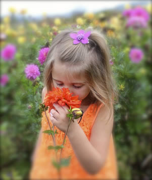 girl smelling flowers small